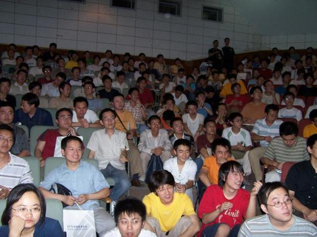 Students sitting in the aisle at  Xian Jiaotong University
